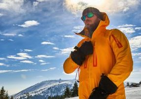 Skier in colerful outfit in a scenic mountain enviroment